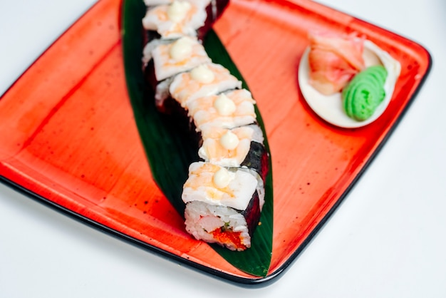 Close up of the nori sushi covered with shrimp, in white background Free Photo