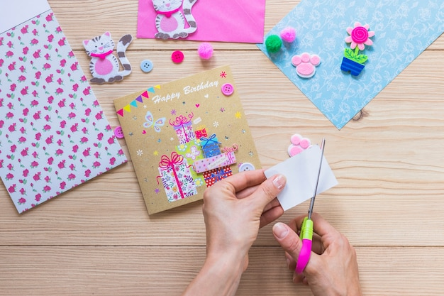 Close up of a person making happy birthday greeting card photo close up of a person making happy birthday greeting card free photo m4hsunfo