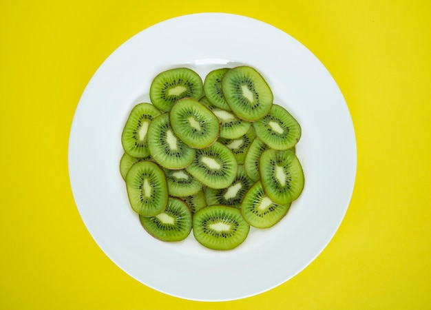 Close up of a plate of green kiwi fruit slices 53876 30440
