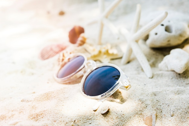 Close-up of a sunglasses on beach Free Photo