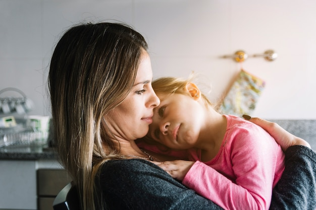 Close-up of a woman with her daughter Free Photo