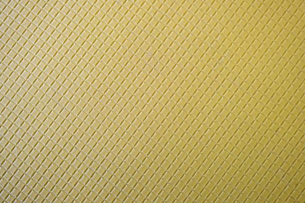 幾何学模様と抽象的な黄色の背景のクローズアップ。 Premium写真