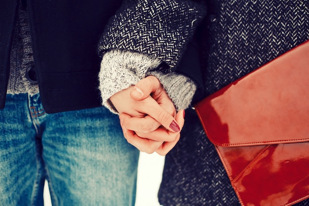 Close-up of clasped hands of a romantic couple Free Photo