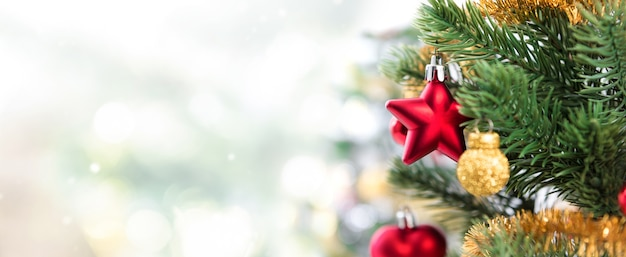 Close up of colorful ornaments on Christmas tree, panoramic banner background Premium Photo