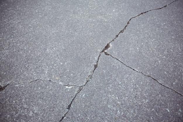 closeup of cracked asphalt road background photo free