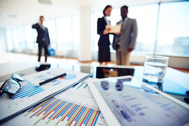 Close-up of financial report with businesspeople background Free Photo