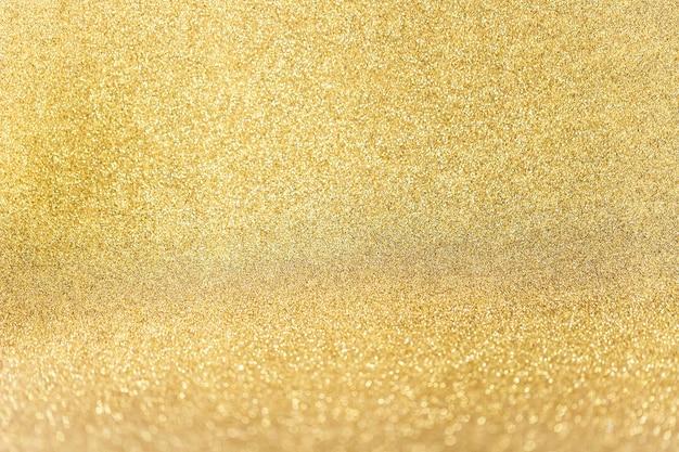 金色のキラキラ背景のクローズアップ 無料写真