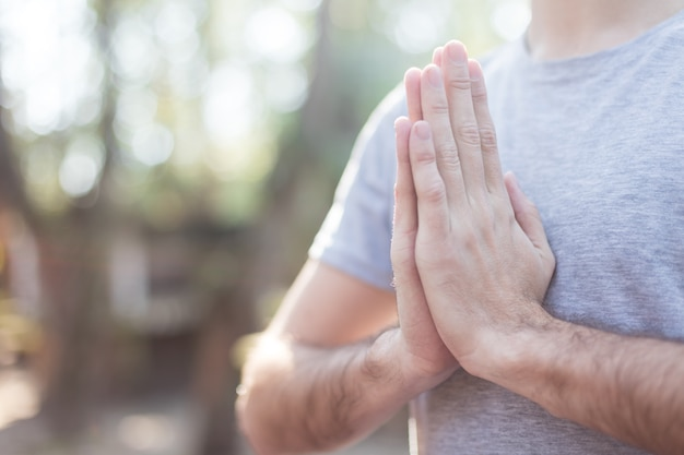 Close-up of guy with hands together Free Photo