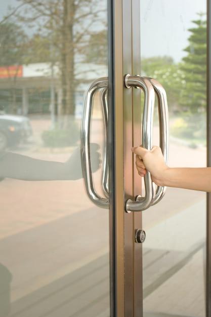 Close Up Of Hand Open Aluminum Glass Door Or Hand Holding Handle