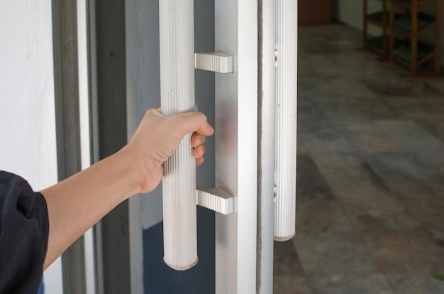 Close Up Of Hand Open Aluminum Glass Door Or Hand Holding Handle Premium  Photo