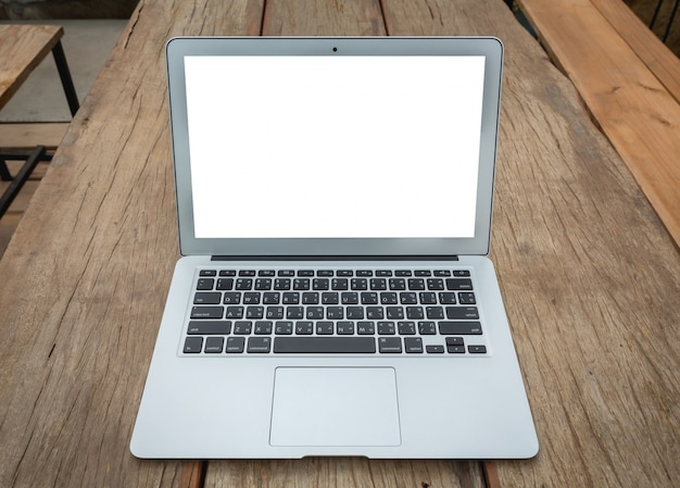 Close up of laptop on wooden table photo free download