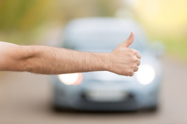 Close up of male hand hitchhiking 1163 2677