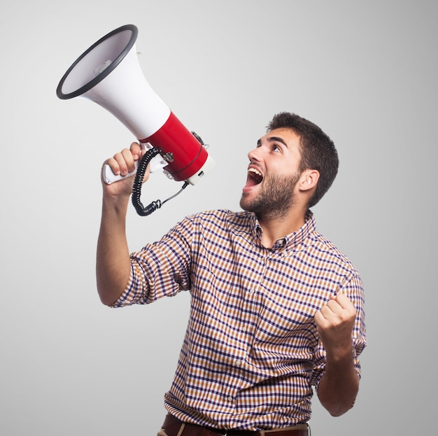 Close up of man, who screaming in the megaphone Free Photo