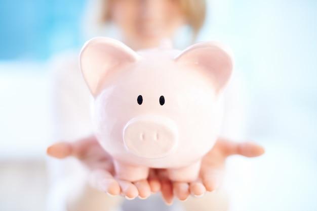 Close-up of piggy bank Free Photo