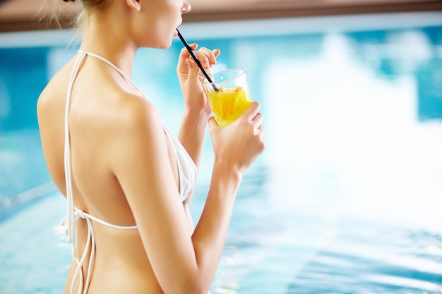Close-up of pleased woman drinking lemonade Free Photo