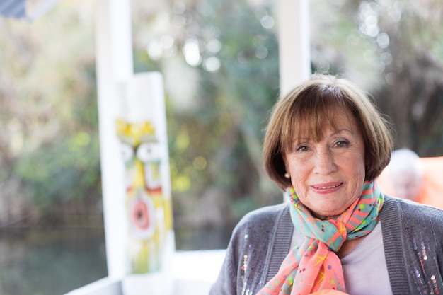 Close-up of retired woman with handkerchief and cardigan Free Photo