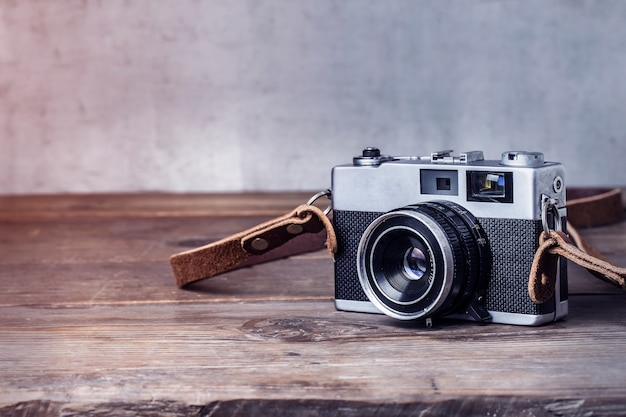 Close-up of vintage camera on wooden table Free Photo