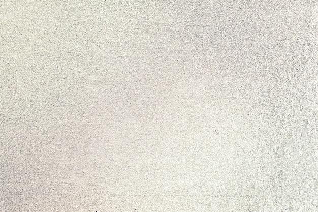 노란색 반짝이 질감 배경의 클로즈업 무료 사진