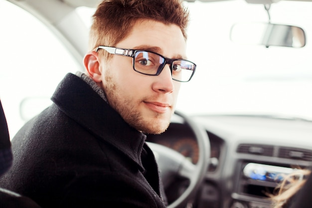 Close Up Of Young Man With Glasses Sitting In The Car Free Photo