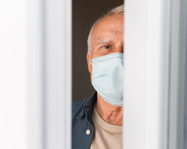 Close-up old man with mask indoors Premium Photo