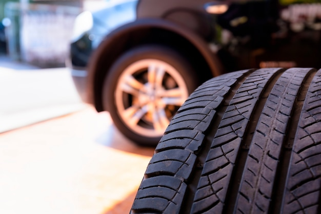 Close up of old tire with car wheel. tire workshop and change old wheel on the car. Premium Photo