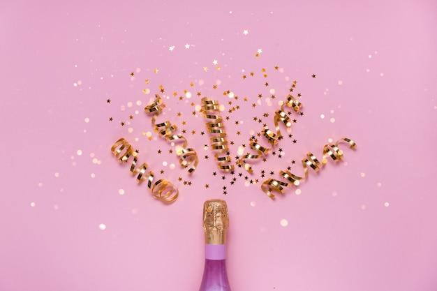 紙吹雪とシャンパンのクローズアップ Premium写真