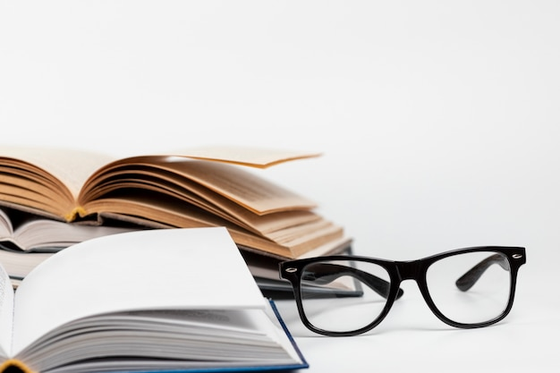 Close-up open books with glasses Free Photo