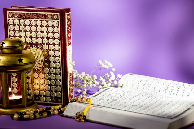 Close up open quran with purple background Free Photo