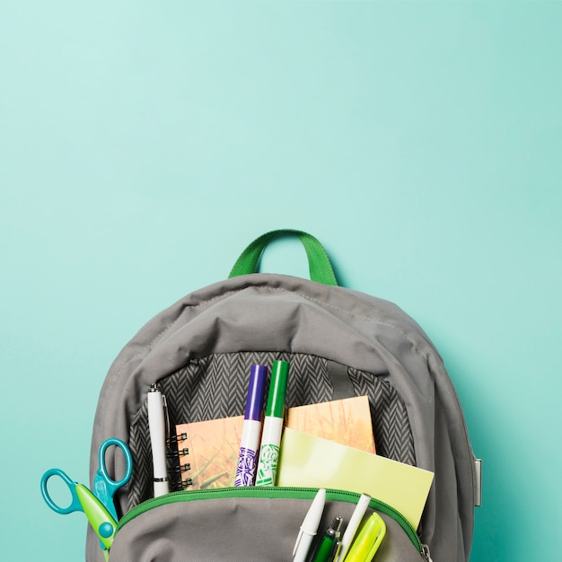 Close up opened backpack with school accessories Free Photo