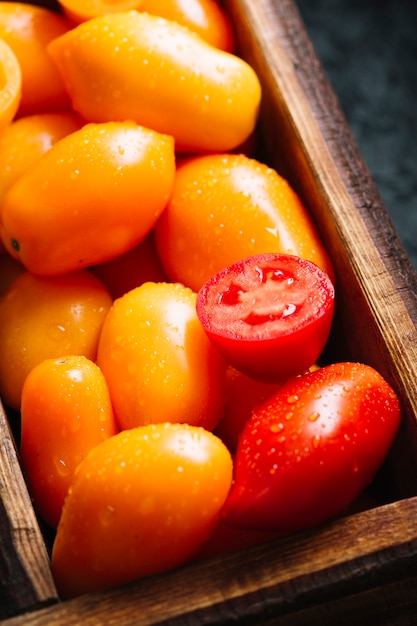 Close-up orange and red small tomatoes Free Photo