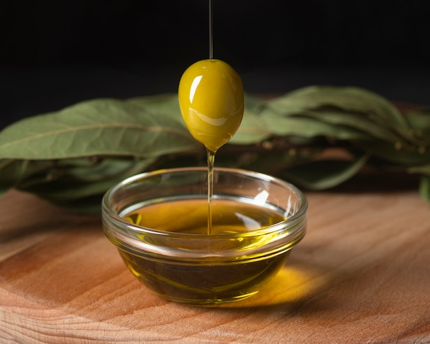 Close-up organic olive and oil Free Photo