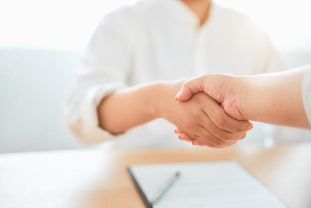 Close up of partnership handshake successful after negotiating business Premium Photo