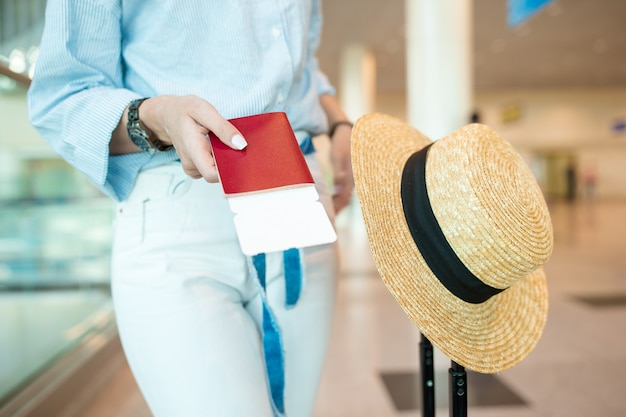 Close-up of passports and boarding pass in female hands at airport Premium Photo