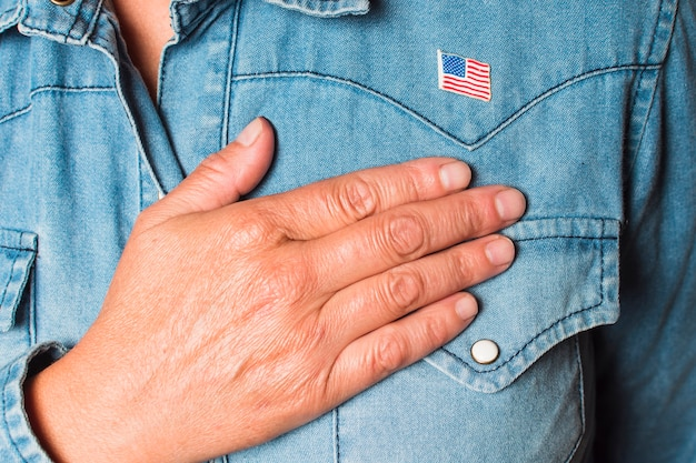 Close-up of a patriotic woman with hand on heart Free Photo