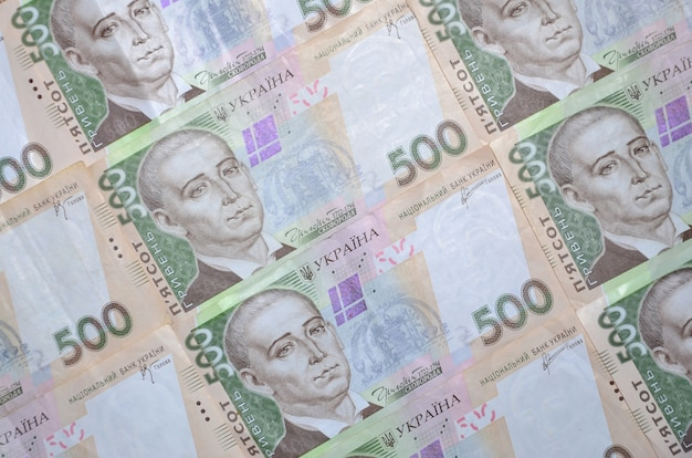 A close-up of a pattern of many ukrainian currency banknotes Premium Photo