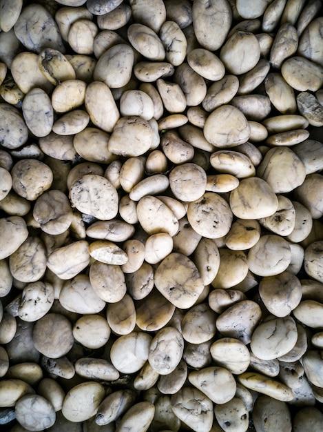 Close up the pebble stone texture background Premium Photo