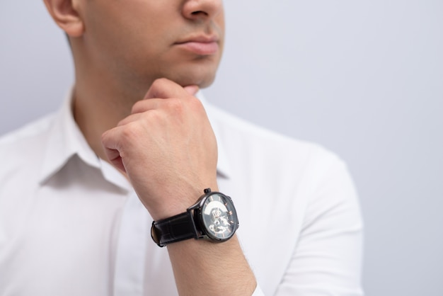 Close-up of pensive young businessman with hand on chin Free Photo