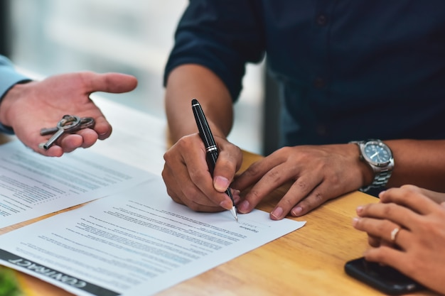 Close up people are signing house purchase contracts corporate work  signing buying  home, people investment estate contract business meeting financial signature Premium Photo