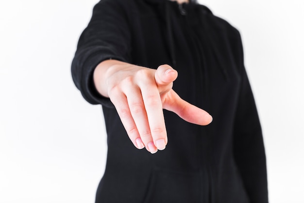 Close-up of a person pointing fingers Free Photo