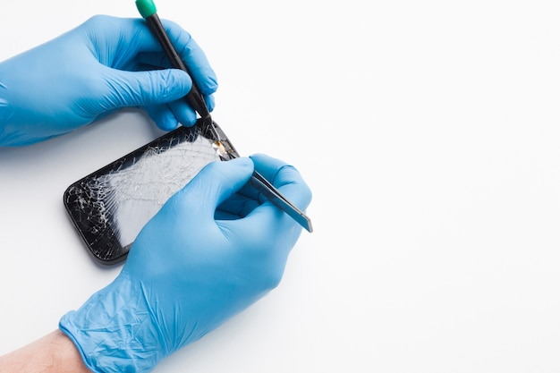 Close-up person repairing a smartphone Premium Photo