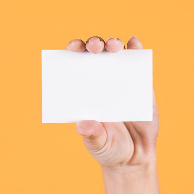 Close-up of person's hand holding blank visiting card Free Photo