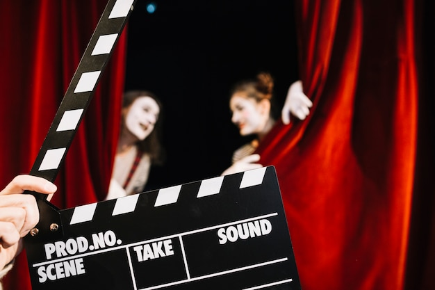 Close-up of a person's hand holding clapperboard Free Photo