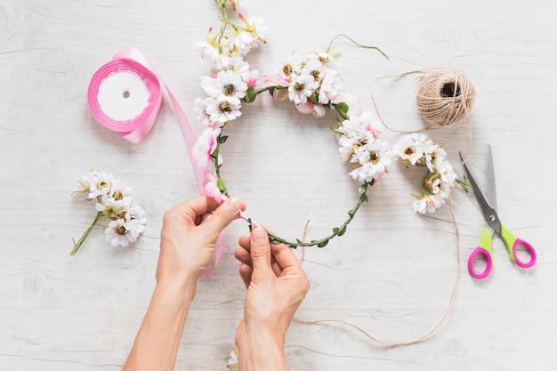 Close-up of person's hand making handmade headbands Free Photo