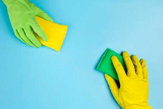 Close-up persons with different gloves and sponges Free Photo