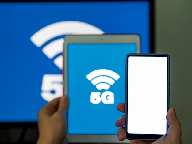 Close-up phone and tablet with 5g Free Photo