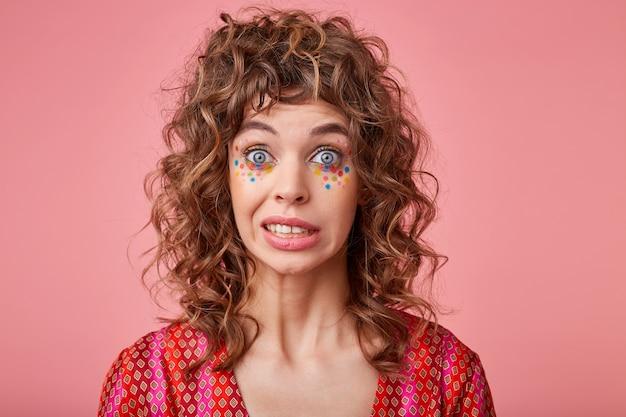 Close up photo of beautiful lady with big eyes opened feeling awkward, lifting eyebrows, saying oops, isolated Free Photo