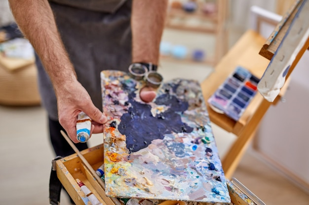 Close-up photo of different materials and tools for painting, drawing, art, craft concept Premium Photo