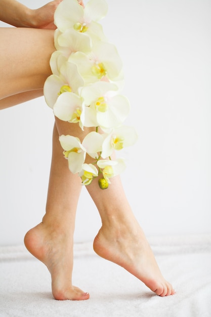 Close up photo of a female feet at spa salon on pedicure procedure Premium Photo