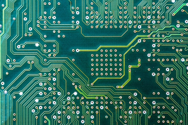close up photo of green computer circuit board for use as a background premium