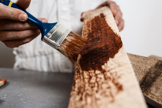 Close up photo of painting wood in brown color. Free Photo